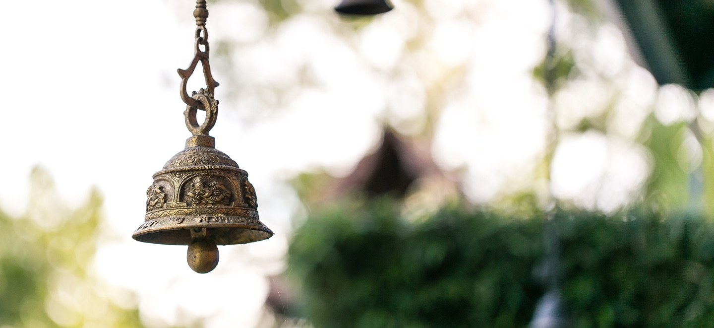 hanging bell with blurred background.