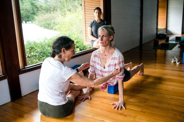 Learning Yoga Pose Adjustments