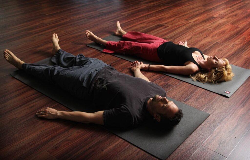 partner yoga poses for two people | savasana | corpse pose